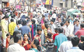 The giant crowd swerving their way on busy Lakshmi Road in Pune, Maharashtra.