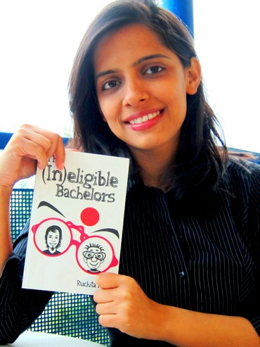 Author Ruchita Mishra posing with her rom-com, The (In) Eligible Bachelors. Image credit: Google India