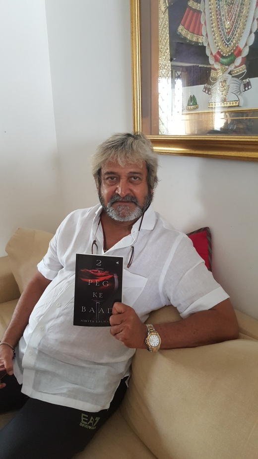 Theater personality and film actor, Mahesh Manjrekar with book copy