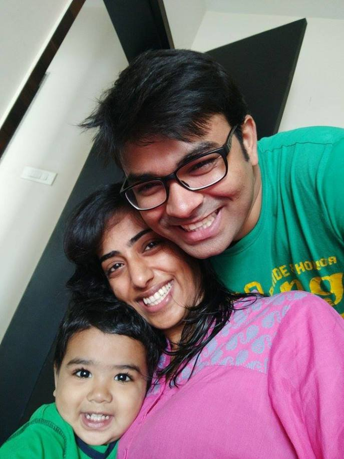 A family that lives together smiles together. Anuja with husband and son.