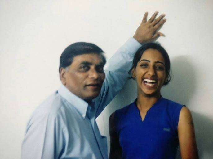 Anuja posing with her Godfather, all smiles.