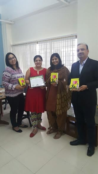 Mayura and Shikha (First and second from left) posing with guests at the launch.